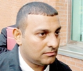 نسيم أثناء دخوله المحكمة وسط اهتمام إعلامي