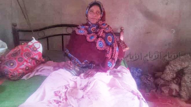 امرأة أصيبت بالحرب وأصبحت طريحة الفراش